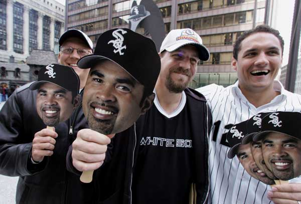 Chicago White Sox fans, from left: Gary Compton, Steve Brach and Adam Lewandowski holds masks bearing the likeness of White Sox manager Ozzie Guillen that were being given away Friday, Oct. 21, 2005, in Chicago&#39;s Daley Plaza. The White Sox host the Houston Astros in Game 1, Saturday, Oct. 22. <span class=meta>(AP Photo&#47;M. Spencer Green)</span>